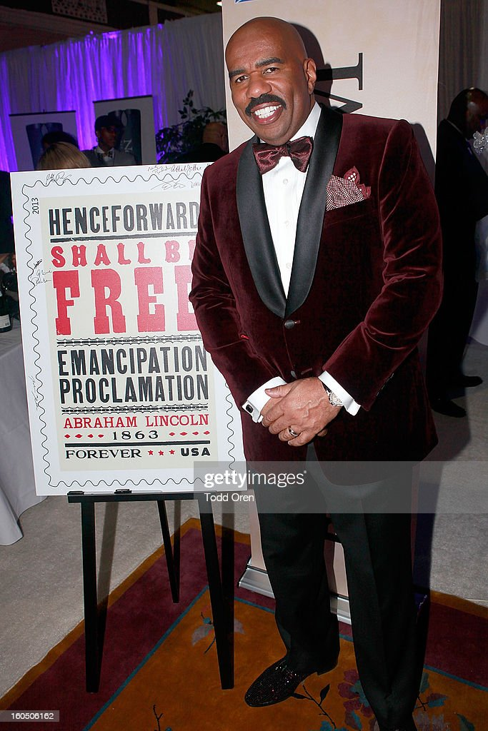 Steve Harvey previews the Emancipation Proclimation Forever Stamp in the U.S. Postal Service Civil Rights Stamp Gallery backstage at the NAACP Image Awards on February 1, 2013 at The Shrine Auditorium.