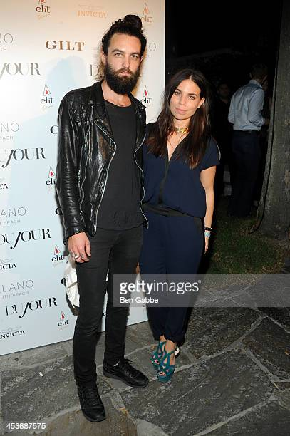 Steve Hash and Ally Hilfiger attend DuJour Magazine's event to honor artist Marc Quinn at Delano South Beach Club on December 4 2013 in Miami Beach...