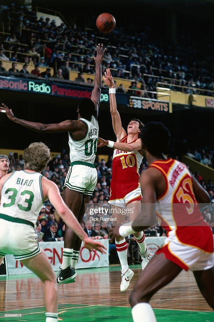 Steve Hawes #10 of the Atlanta Hawks shoots over Robert Parish #00 of the Boston Celtics during a game played in 1983 at the Boston Garden in Boston, Massachusetts.