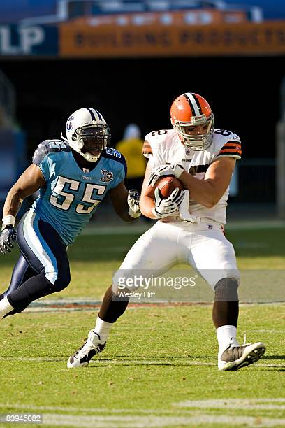 Steve Heiden of the Cleveland Browns catches a pass in front of Stephen Tulloch of the Tennessee Titans at LP Field on December 7 2008 in Nashville...
