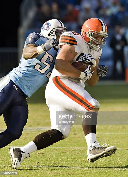Steve Heiden of the Cleveland Browns is tackled by Stephen Tulloch of the Tennessee Titans at LP Field on December 7 2008 in Nashville Tennessee The...