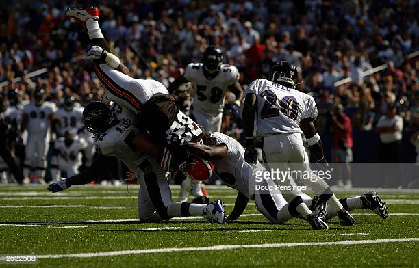Steve Heiden of the Cleveland Browns makes a reception and is brought down by Ray Lewis and Edgerton Hartwell of the Baltimore Ravens on September 14...