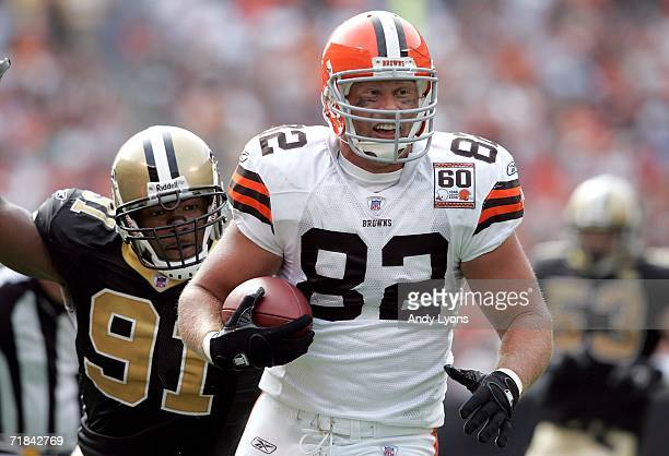 Steve Heiden of the Cleveland Browns runs with the ball while defended by Will Smith of the New Orleans Saints on September 10 2006 at Cleveland...