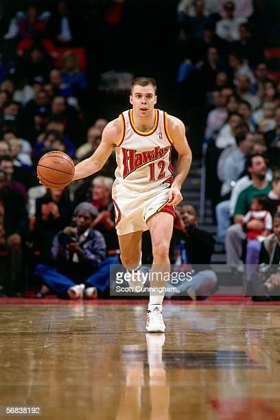 Steve Henson of the Atlanta Hawks brings the ball upcourt against the Detroit Pistons during an NBA game at the Omni circa 1993 in Atlanta Georgia...