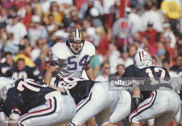 Steve Hoffmann, Defensive Lineman for the University of Washington Huskies watches the Wildcats offensive line during the NCAA Pac-10 Conference...
