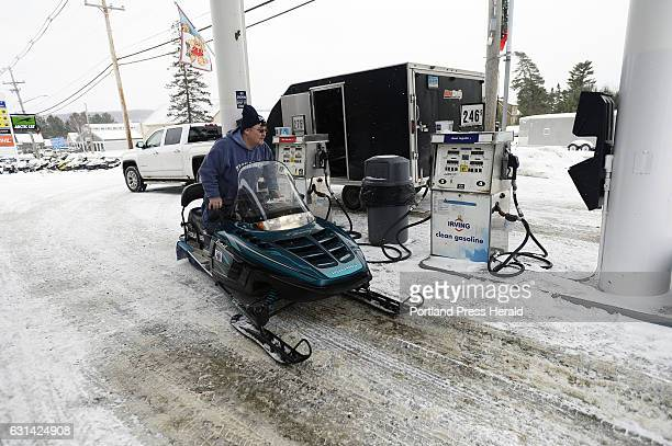 Steve Hogan of Waterford Connecticut rides off on his snowmobile after getting gas at Loony Bin Variety on Main St in Rangeley Wednesday December 28...