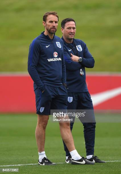 Steve Holland and Manager Gareth Southgate watch on during a England training session ahead of their World Cup Qualifiers against Malta and Slovakia...
