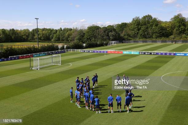 Steve Holland, Assistant Coach of England speaks with players and coaches ahead of the England training session on June 04, 2021 in Middlesbrough,...