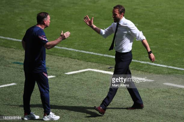 Steve Holland, Assistant Head Coach of England and Gareth Southgate, Head Coach of England celebrate following their team's victory in the UEFA Euro...