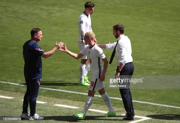 Steve Holland, Assistant Head Coach of England greets Phil Foden of England as he is substituted off during the UEFA Euro 2020 Championship Group D...