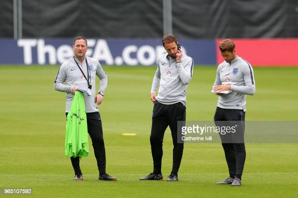 Steve Holland Gareth Southgate and Allan Russell speak during the England training session at The Grove Hotel on June 1 2018 in Hertford England
