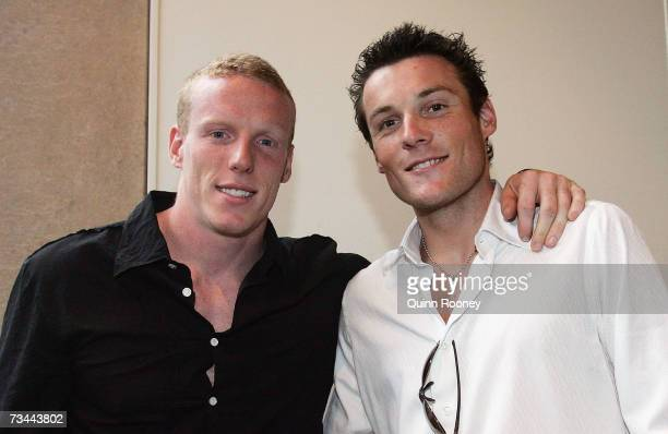Steve Hooker and Craig Mottram of Australia pose together during the Athletics Australia John Landy Lunch Club and Melbourne Telstra ASeries Media...