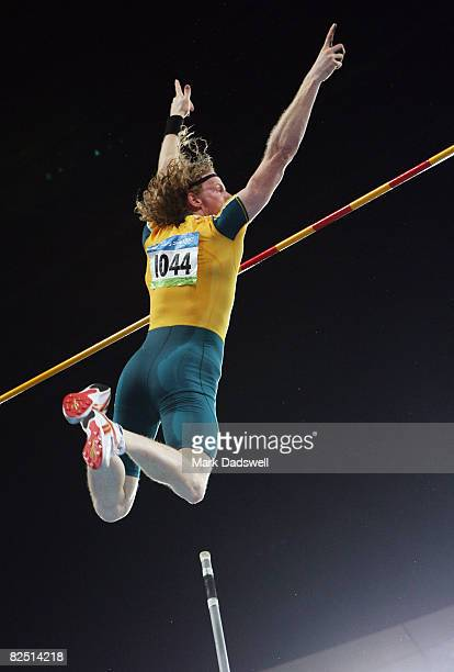 Steve Hooker of Australia celebrates the gold medal after completing the winning jump in the Men's Pole Vault Final at the National Stadium on Day 14...