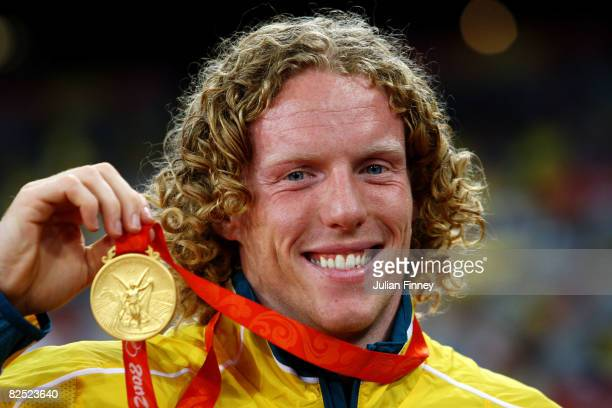 Steve Hooker of Australia receives the gold medal during the medal ceremony for the Men's Pole Vault Final held at the National Stadium on Day 15 of...