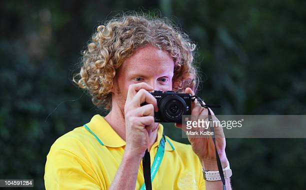 Steve Hooker takes pictures of the media as he arrives at the Australian Team Reception and announcement of the opening ceremony flag bearer for the...