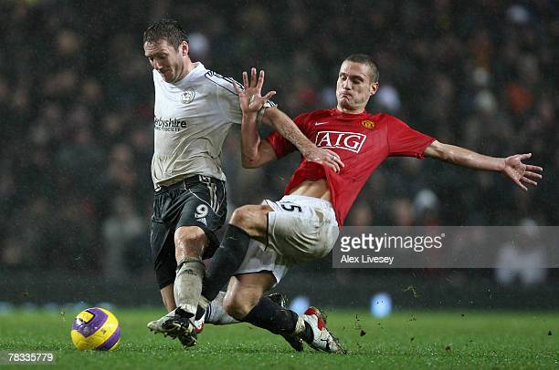 Steve Howard of Derby County is tackled by Nemanja Vidic of Manchester United during the Barclays Premier League match between Manchester United and...