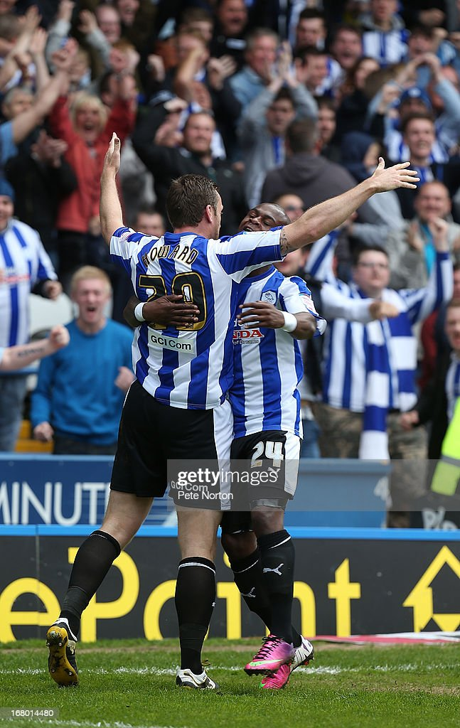 Steve Howard of Sheffield Wednesday celebrates with team mate Leroy Lita after scoring his sides first goal during the npower Championship match between Sheffield Wednesday and Middlesbrough at Hillsborough Stadium on May 4, 2013 in Sheffield, England.