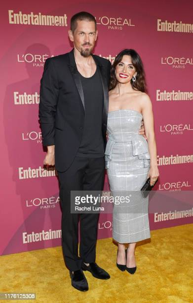 Steve Howey and Sarah Shahi attend the 2019 Entertainment Weekly PreEmmy Party at Sunset Tower on September 20 2019 in Los Angeles California