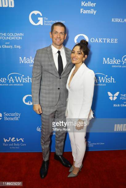 Steve Howey and Sarah Shahi attend the 2019 Wish Gala on November 20 2019 in Beverly Hills California