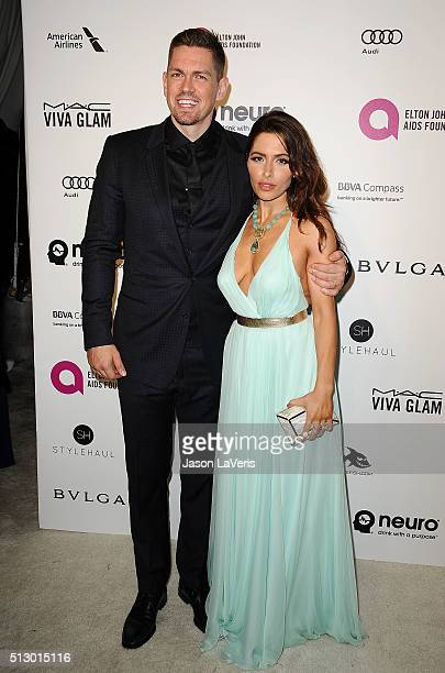 Steve Howey and Sarah Shahi attend the 24th annual Elton John AIDS Foundation's Oscar viewing party on February 28 2016 in West Hollywood California