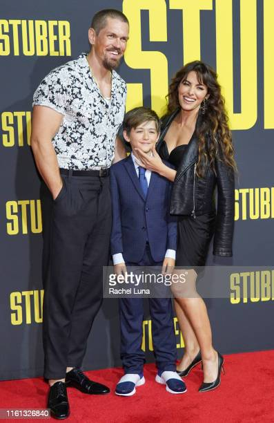 Steve Howey Sarah Shahi and their son William Howey attend the premiere of 20th Century Fox's Stuber at Regal Cinemas LA Live on July 10 2019 in Los...