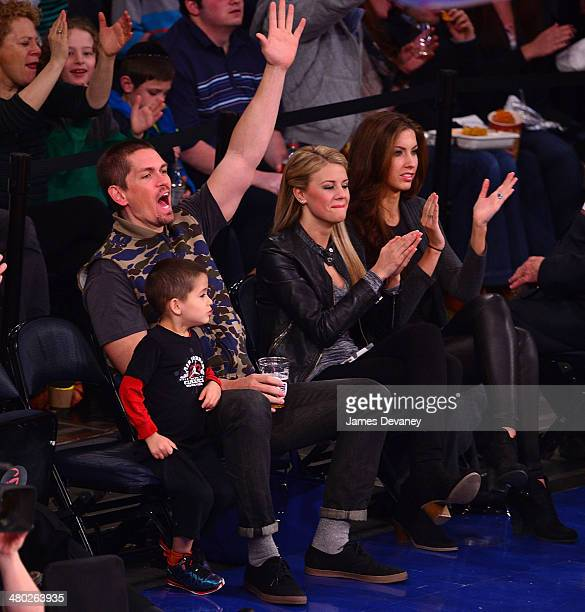 Steve Howey William Howey guest and Katherine Webb attend the Cleveland Cavaliers vs New York Knicks game at Madison Square Garden on March 23 2014...
