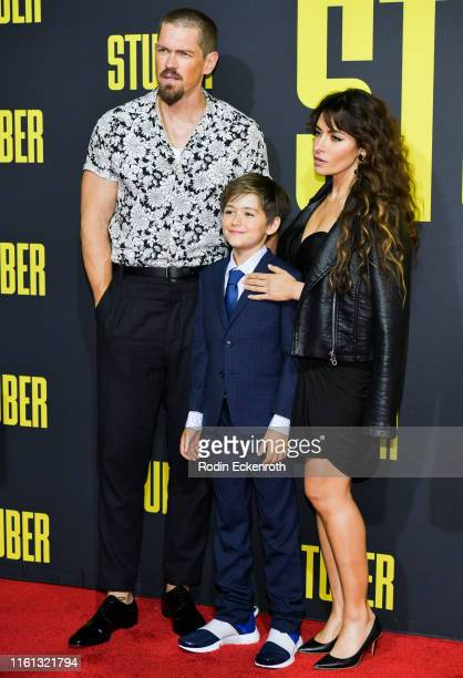 Steve Howey William Wolf Howey and Sarah Shahi attend the premiere of 20th Century Fox's Stuber at Regal Cinemas LA Live on July 10 2019 in Los...