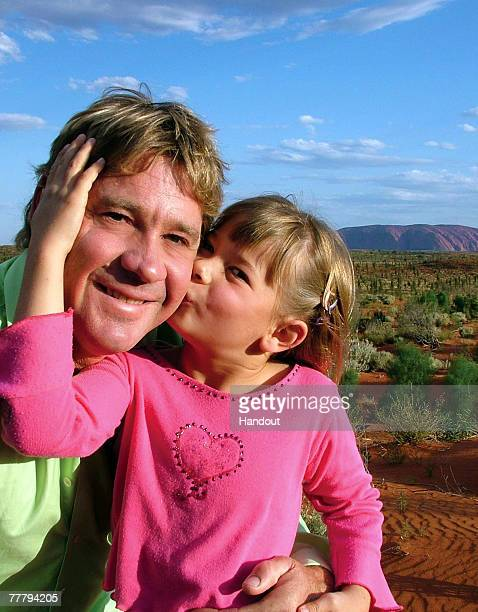 Steve Irwin poses with his daughter Bindi Irwin October 2, 2006 in Uluru, Australia.