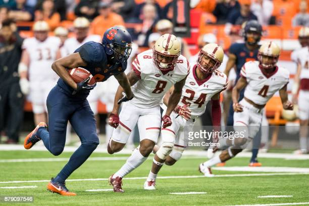 Steve Ishmael of the Syracuse Orange carries the ball for a touchdown reception during the first quarter against the Boston College Eagles to tie the...