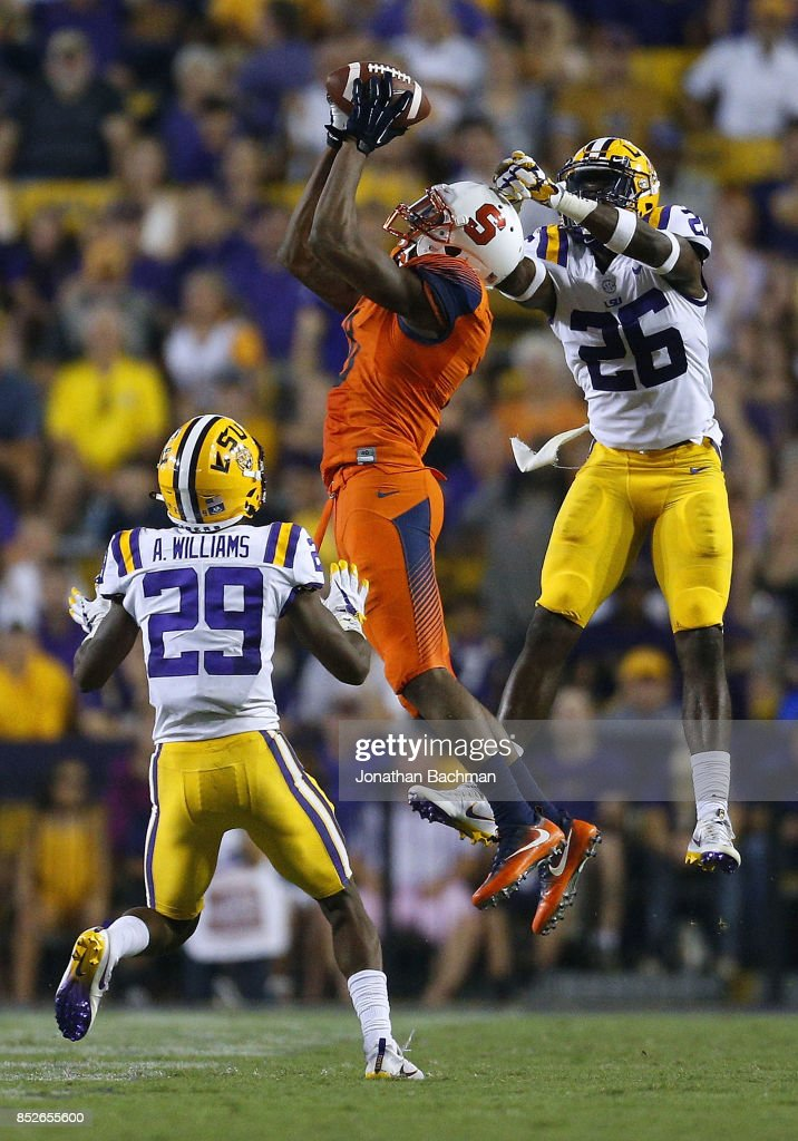 Steve Ishmael #8 of the Syracuse Orange catches the ball over John Battle #26 of the LSU Tigers and Andraez Williams #29 during the second half of a game at Tiger Stadium on September 23, 2017 in Baton Rouge, Louisiana.