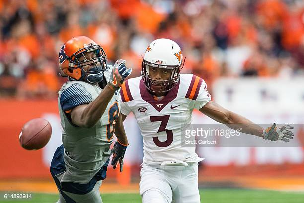 Steve Ishmael of the Syracuse Orange fails to catch a pass as Greg Stroman of the Virginia Tech Hokies defends during the first quarter on October 15...