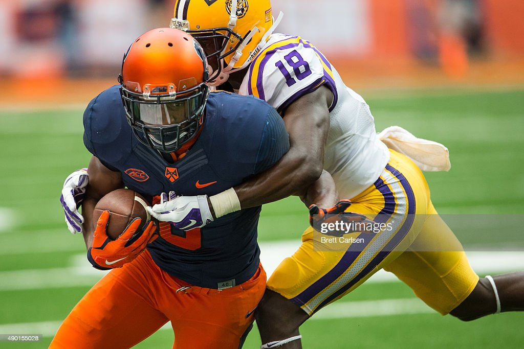 Steve Ishmael #8 of the Syracuse Orange is pushed out of bounds by Tre'Davious White #18 of the LSU Tigers following a reception during the fourth quarter on September 26, 2015 at The Carrier Dome in Syracuse, New York. LSU defeats Syracuse 34-24.