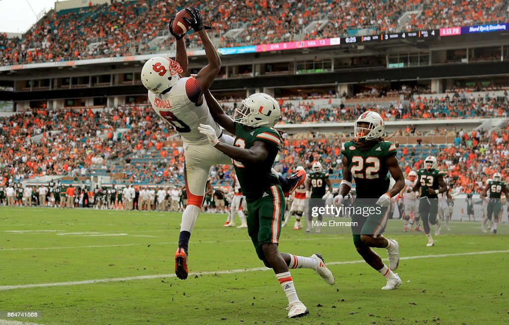 Steve Ishmael #8 of the Syracuse Orange scores a touchdown over Malek Young #12 of the Miami Hurricanes during a game at Sun Life Stadium on October 21, 2017 in Miami Gardens, Florida.