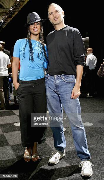 Steve Jobs Chief Executive Officer of Apple computers poses for a photo with RB singer Alicia Keys as he launches iTunes Music Store in the...