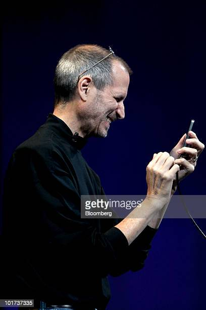 Steve Jobs chief executive officer of Apple Inc demonstrates the gyroscope functionality of the iPhone 4 during his keynote address at the Apple...