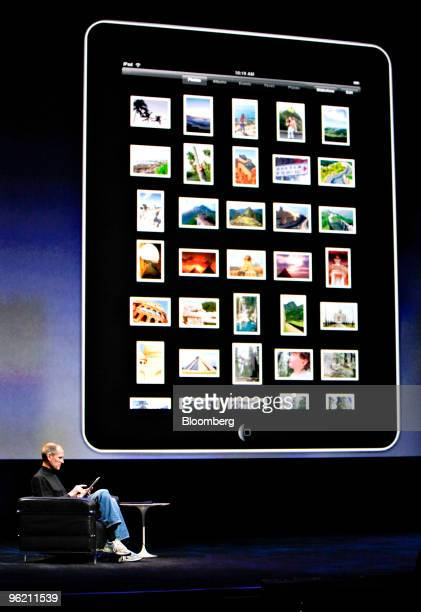 Steve Jobs chief executive officer of Apple Inc demonstrates the Apple iPad tablet during its debut at the Yerba Buena Center for the Arts Theater in...