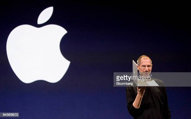 Steve Jobs chief executive officer of Apple Inc displays the new MacBook Air laptop computer during his keynote address at the MacWorld conference in...