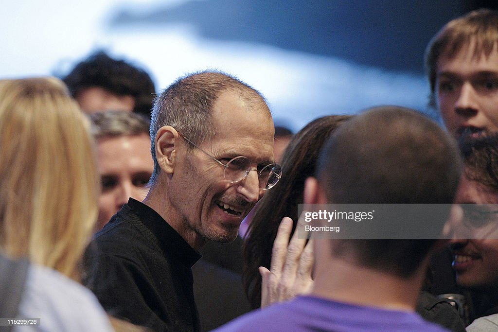 Steve Jobs, chief executive officer of Apple Inc., greets members of the audience after unveiling the iCloud storage system at the Apple Worldwide Developers Conference 2011 in San Francisco, California, U.S., on Monday, June 6, 2011. Apple is using iCloud to retain its dominance in the smartphone and tablet markets amid fresh competition from devices powered by Google Inc.'s Android software. Photographer: David Paul Morris/Bloomberg via Getty Images