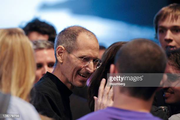 Steve Jobs chief executive officer of Apple Inc greets members of the audience after unveiling the iCloud storage system at the Apple Worldwide...