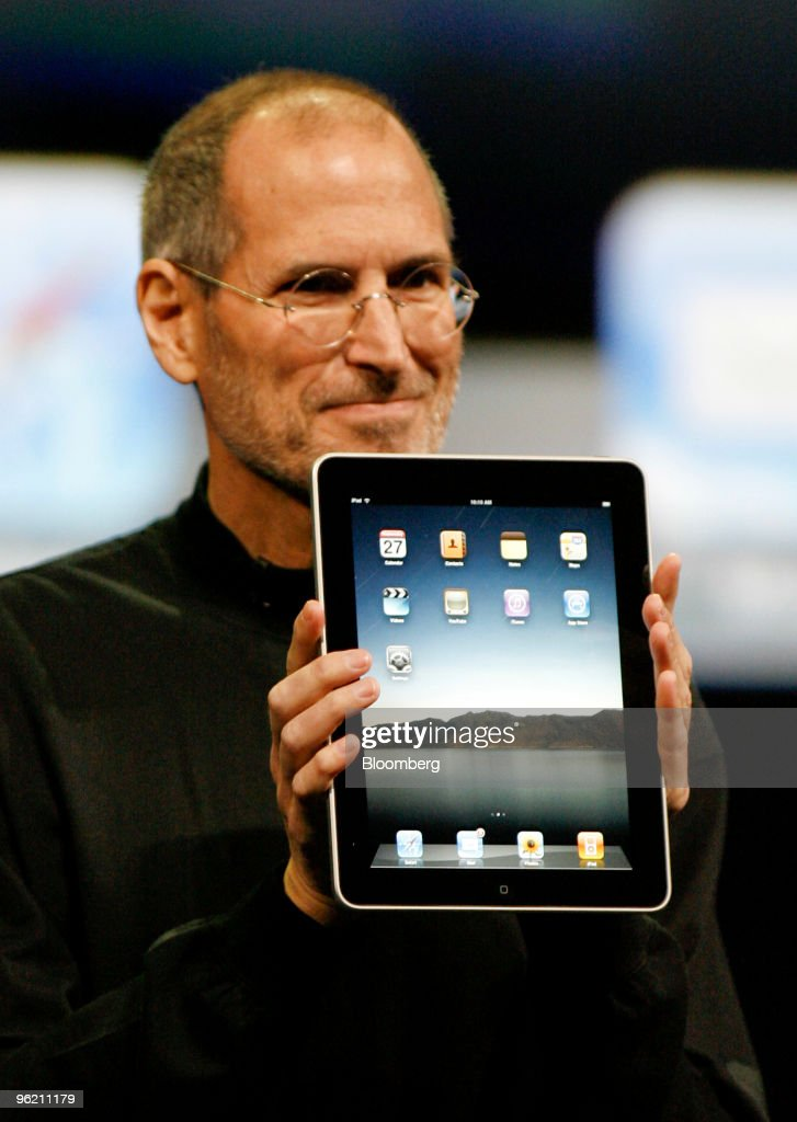 Steve Jobs, chief executive officer of Apple Inc., holds an Apple iPad tablet during its debut at the Yerba Buena Center for the Arts Theater in San Francisco, California, U.S., on Wednesday, Jan. 27, 2010. Apple Inc., trying to expand beyond the Macintosh, iPod and iPhone, introduced the iPad, a tablet computer with a touch screen. Photographer: Tony Avelar/Bloomberg via Getty Images