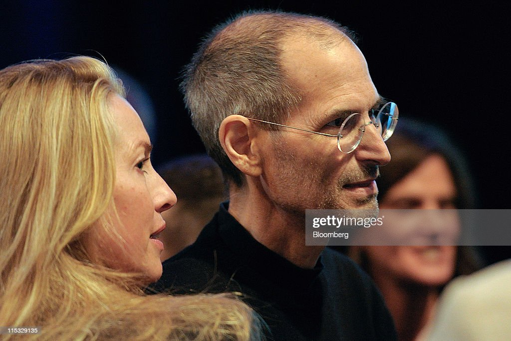 Steve Jobs, chief executive officer of Apple Inc., right, greets members of the audience with his wife Laurene Powell Jobs after unveiling the iCloud storage system at the Apple Worldwide Developers Conference 2011 in San Francisco, California, U.S., on Monday, June 6, 2011. Apple is using iCloud to retain its dominance in the smartphone and tablet markets amid fresh competition from devices powered by Google Inc.'s Android software. Photographer: David Paul Morris/Bloomberg via Getty Images