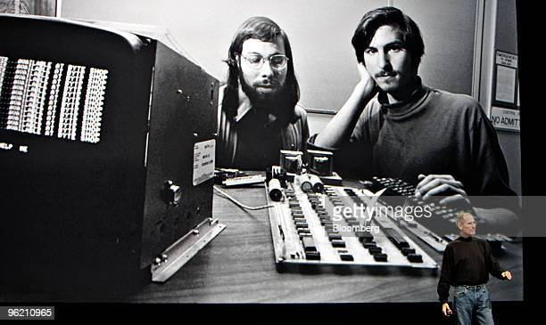 Steve Jobs chief executive officer of Apple Inc right speaks in front of a file photograph of himself and Apple cofounder Steve Wozniak during the...