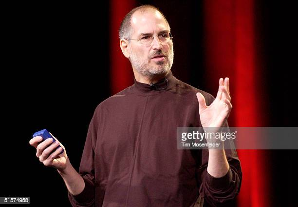 Steve Jobs of Apple Computer celebrates the release of a new Apple iPod family of products at the California Theatre on October 26, 2004 in San Jose,...