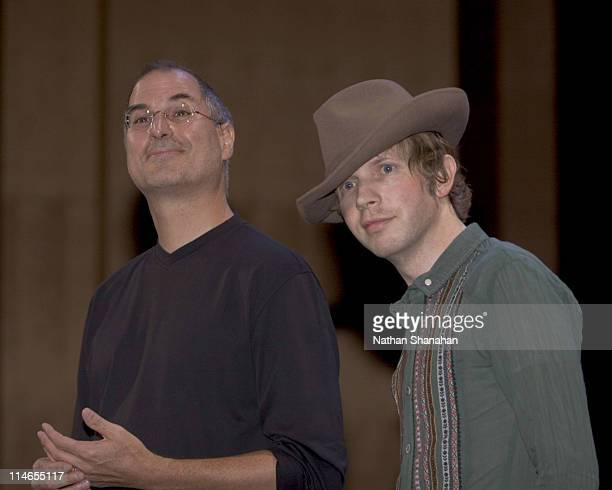 Steve Jobs talks with Beck who performed at the launch of the iTunes Music Store in Japan at the Tokyo International Forum August 4 2005 The...