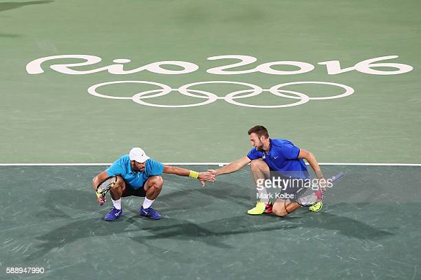 Steve Johnson and Jack Sock of the United States celebrate a point during the Men's Doubles Bronze medal match against Vasek Pospisil and Daniel...