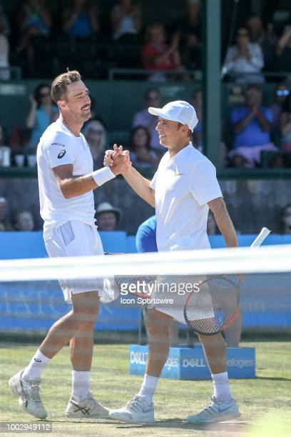 Steve Johnson is congratulated by Dudi Sela after their quarterfinal match up of the Dell Technologies Hall of Fame Open at the International Tennis...