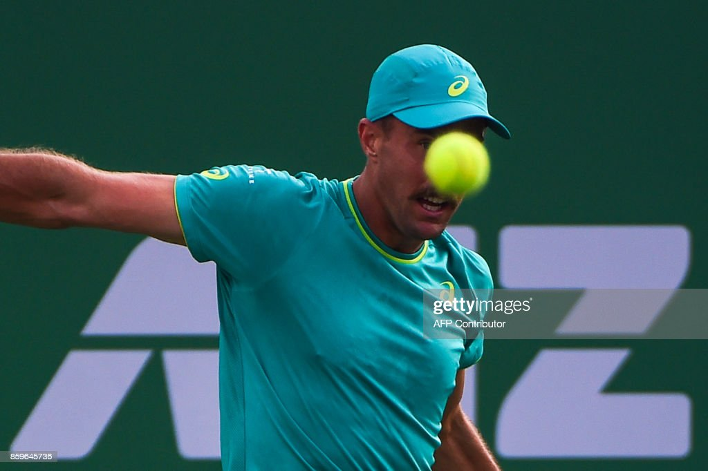 Steve Johnson of America hits a return during the men's singles against Nick Kyrgios of Australia at the Shanghai Masters tennis tournament in Shanghai on October 10, 2017. /