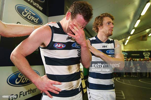 Steve Johnson of the Cats cries with Cameron Guthrie after playing his last game for the club during the round 23 AFL match between the Geelong Cats...