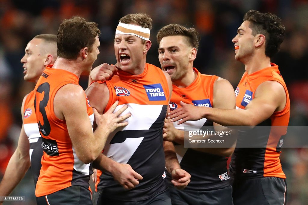 Steve Johnson of the Giants celebrates kicking a goal with team mates during the AFL First Semi Final match between the Greater Western Sydney Giants and the West Coast Eagles at Spotless Stadium on September 16, 2017 in Sydney, Australia.