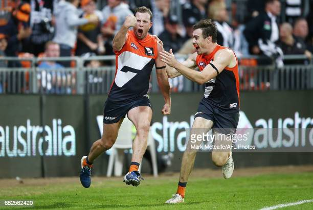 Steve Johnson of the Giants celebrates with team mate Jeremy Cameron after kicking the winning goal during the round eight AFL match between the...